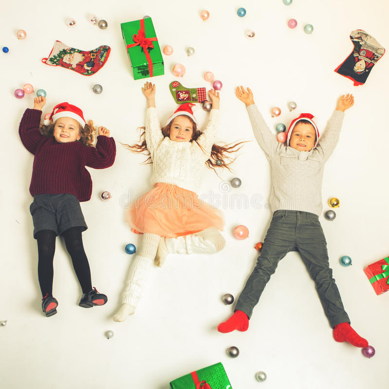 Enfants 2016 mignons de Black Friday de Joyeux Noël petits photos libres de droits
