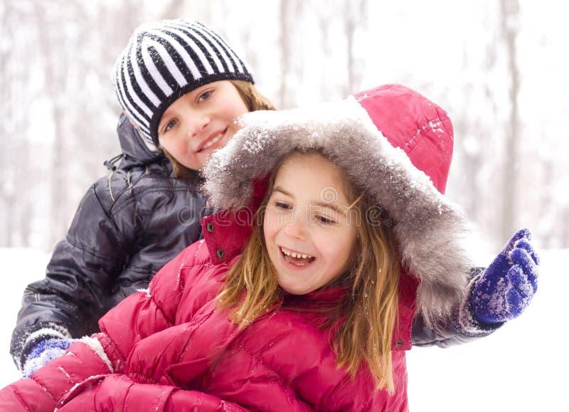 Enfants sur la neige photo stock