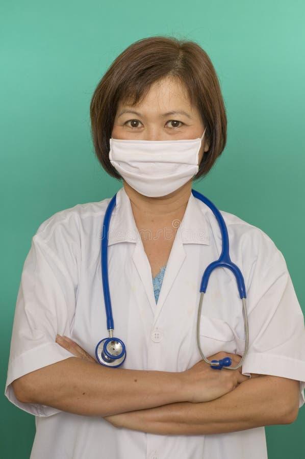 Enfermeira com máscara protectora fotos de stock royalty free