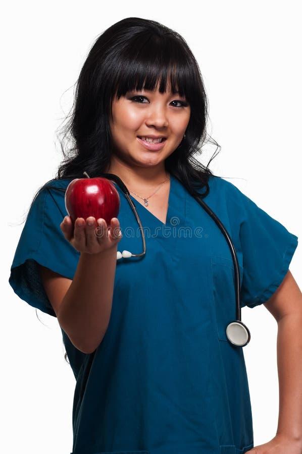 Enfermeira com maçã imagem de stock