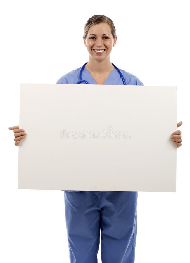 Enfermeira com sinal fotografia de stock