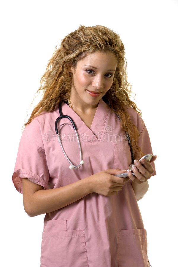 Enfermeira em um telemóvel imagem de stock