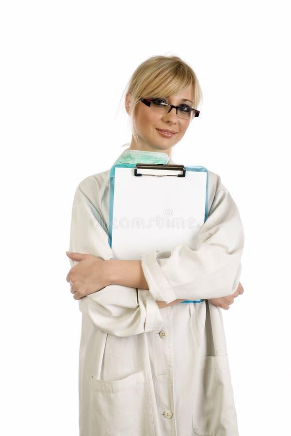 Enfermeira loura com bloco de notas azul fotos de stock royalty free
