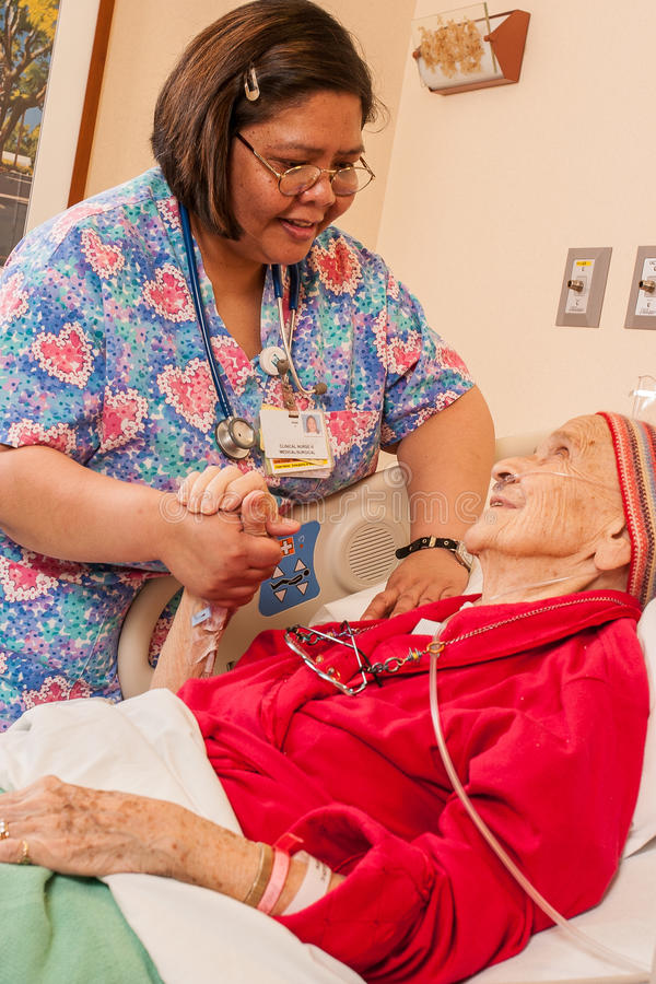 Enfermeira na unidade Médico-cirúrgica do cuidado imagem de stock royalty free