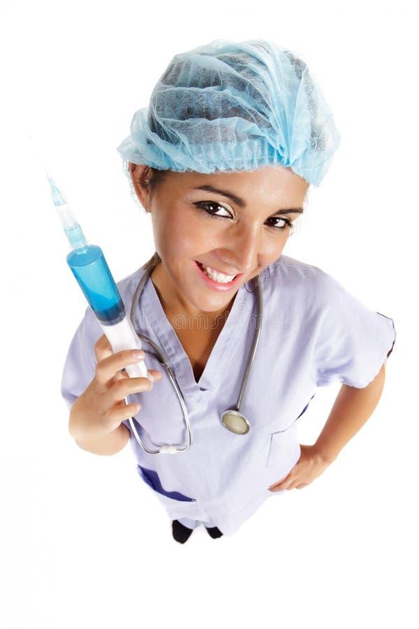 Enfermeira que prende a agulha grande fotos de stock royalty free