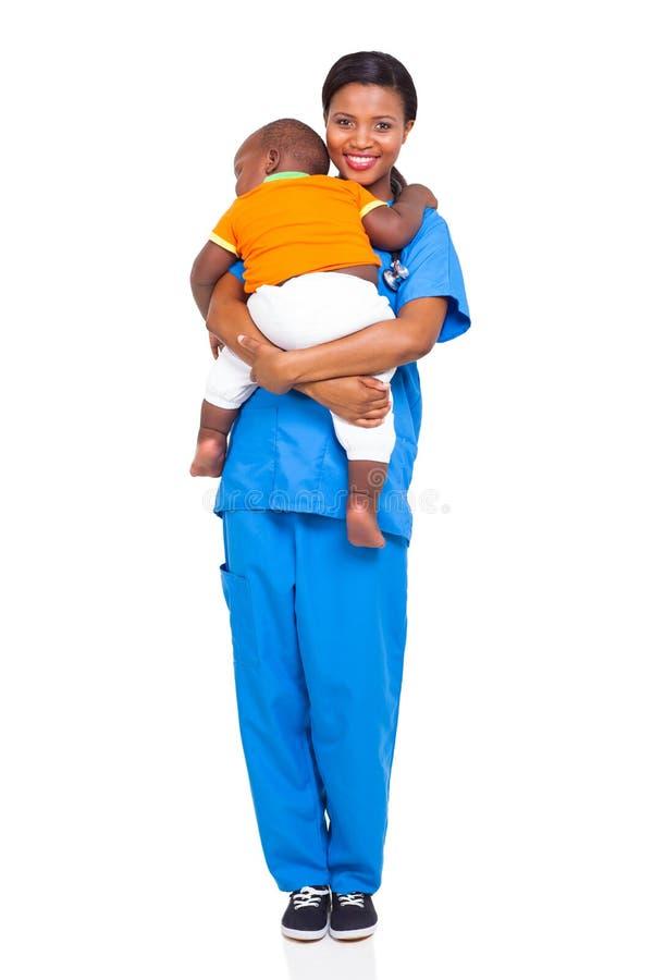 Niño africano de la enfermera fotos de archivo libres de regalías