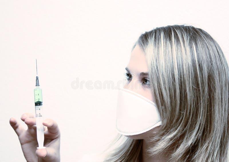 Enfermera con el seringe imagen de archivo