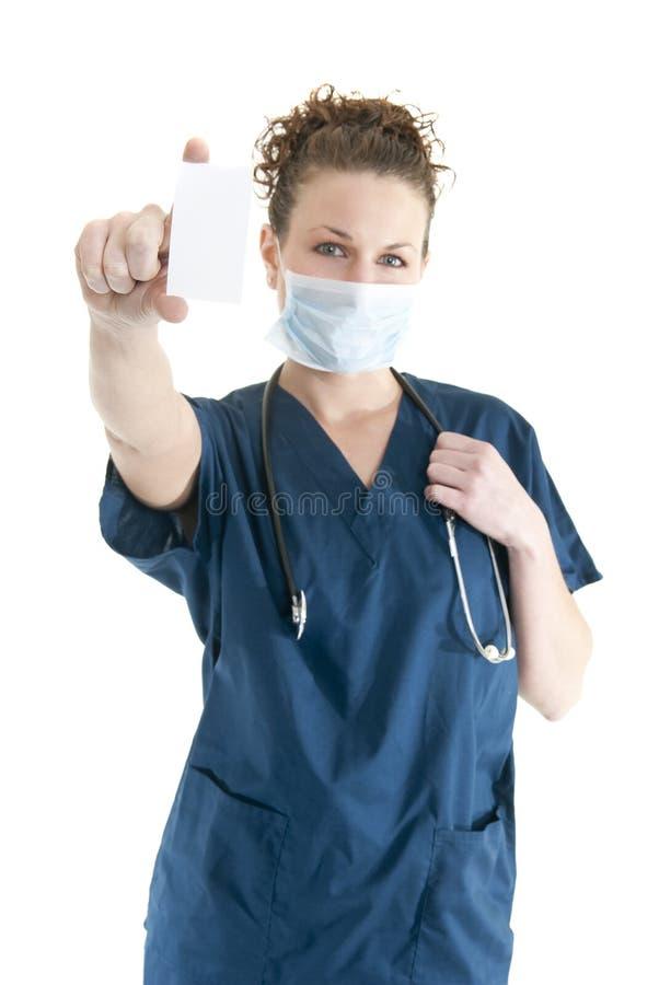 Enfermera con la tarjeta en blanco imagen de archivo