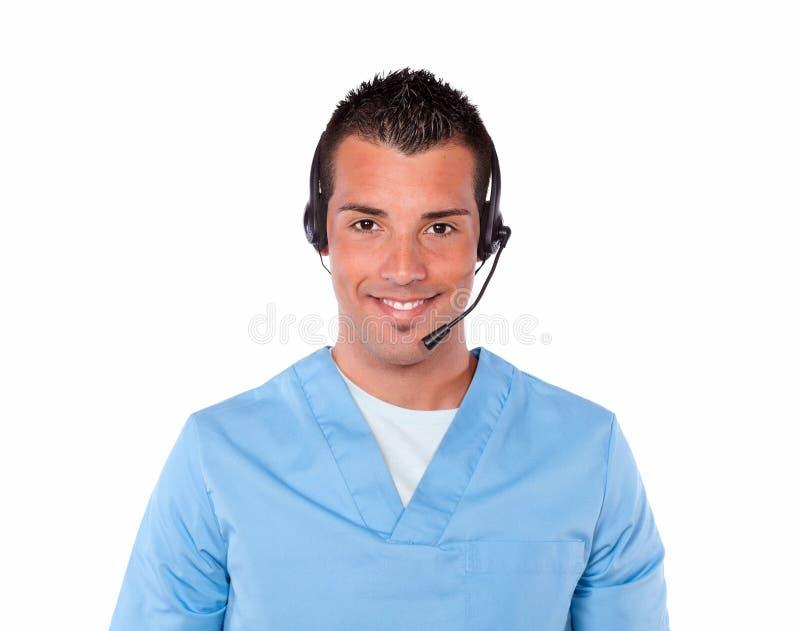 Enfermera de sexo masculino encantadora con la sonrisa del auricular foto de archivo