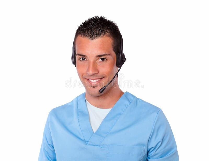 Enfermera de sexo masculino hermosa con la sonrisa de los auriculares fotos de archivo libres de regalías