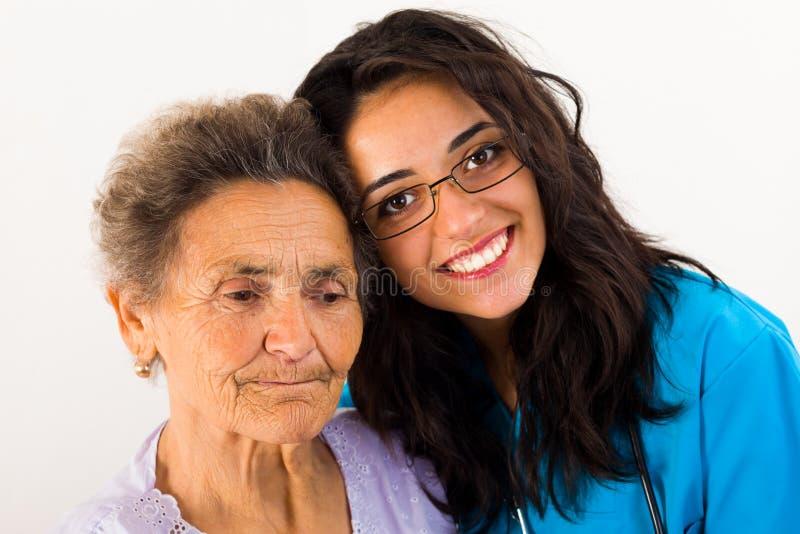Enfermera del miembro de la familia que cuida fotografía de archivo