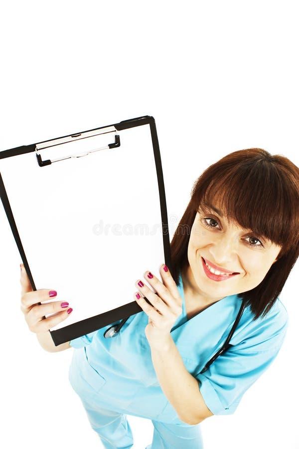 Enfermera/doctor que muestra la muestra en blanco del sujetapapeles fotos de archivo