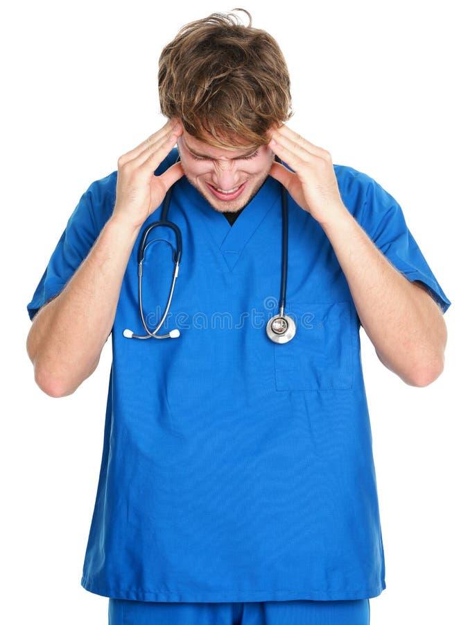 Enfermera/dolor de cabeza y tensión del doctor foto de archivo libre de regalías