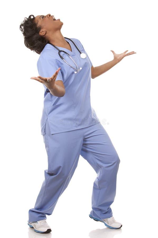 Enfermera muy emocionada imagenes de archivo