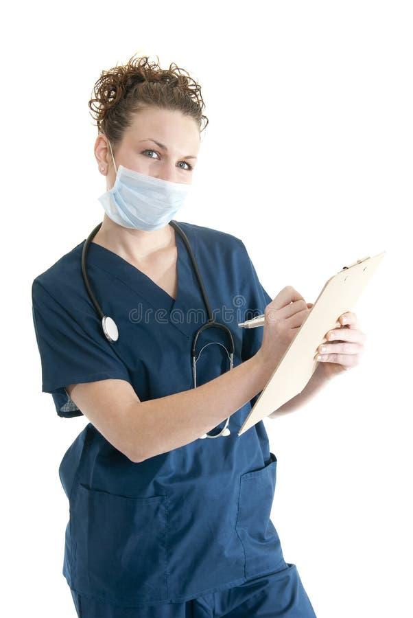 Enfermera que toma notas fotografía de archivo libre de regalías