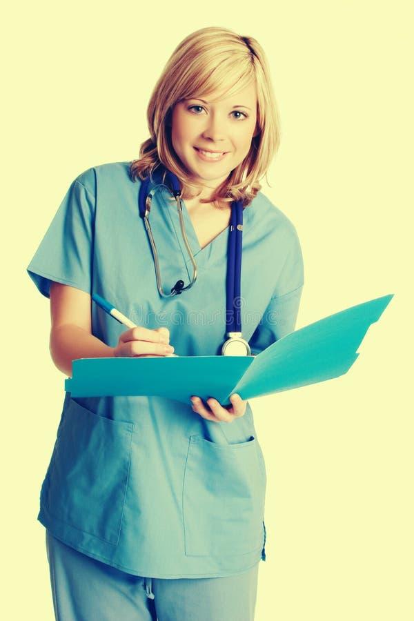 Enfermera sonriente Taking Notes foto de archivo libre de regalías
