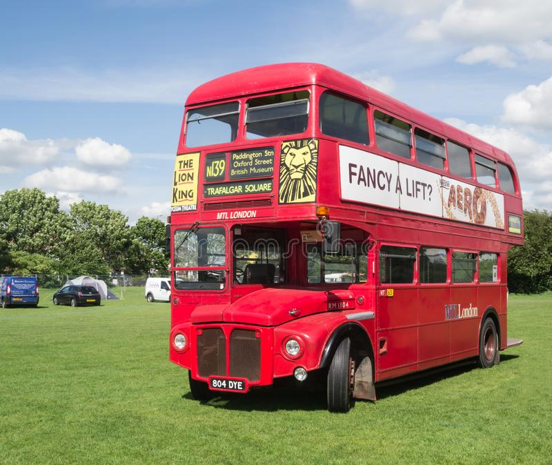 Routemaster bus on display. Enfield, London, UK - May 25 2014: Red London routemaster bus standing in a field on display royalty free stock images