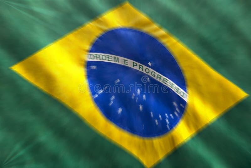 Enfoque brasileño de la bandera borroso imagen de archivo