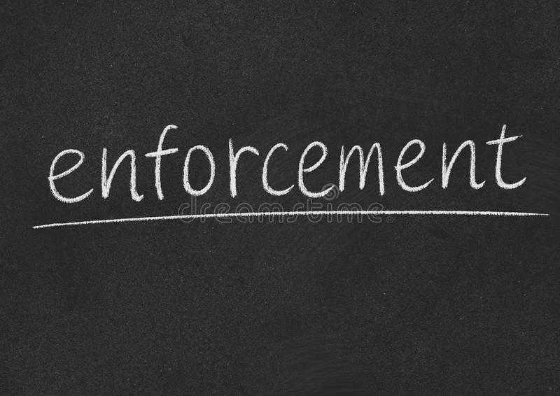 Enforcement. Concept word on a blackboard background stock photos