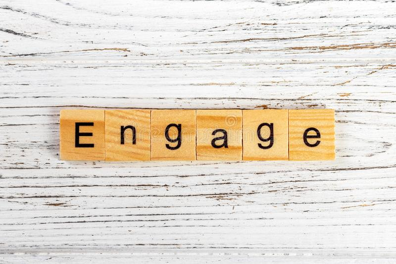 ENGAGE word made with wooden blocks concept.  stock images