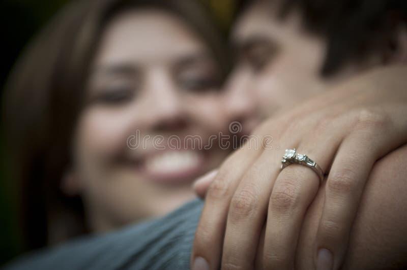 Engaged couple embracing stock photography