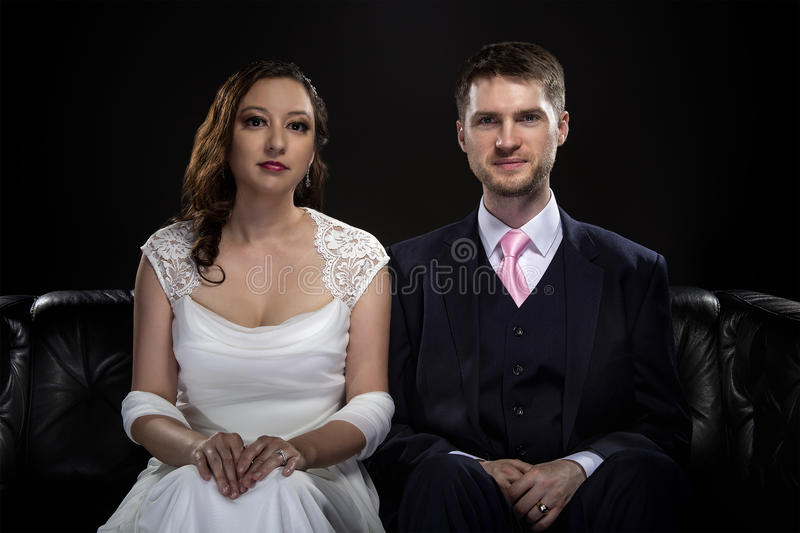 Engaged Couple Modeling Art Deco Style Wedding Suit and Dress stock image