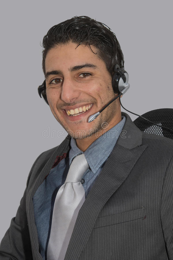 Engaged help desk or telesales employee stock image