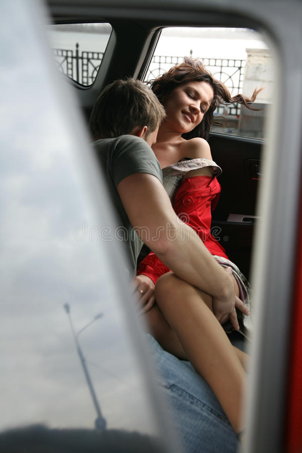 Engagement in the car. Loving couple embraces in the car