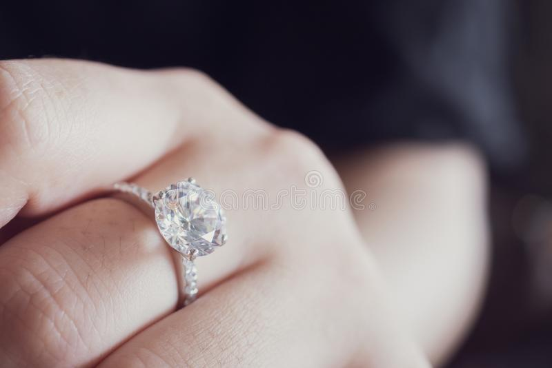 Engagement diamond ring on woman finger closeup royalty free stock photo