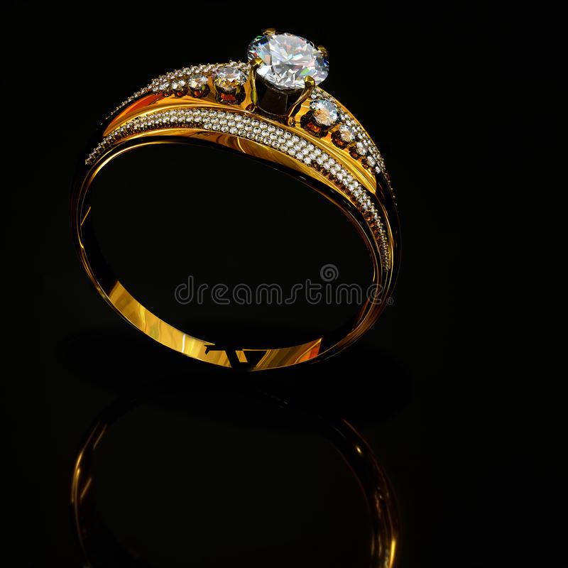 Engagement gold ring with jewelry diamond gem on surface reflection . royalty free stock photography