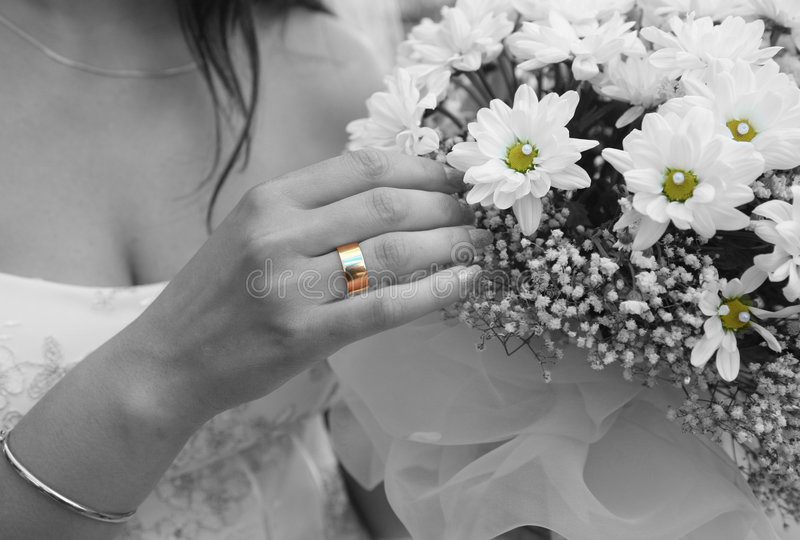 Engagement ring. Hand of a bride with engagement ring royalty free stock photography