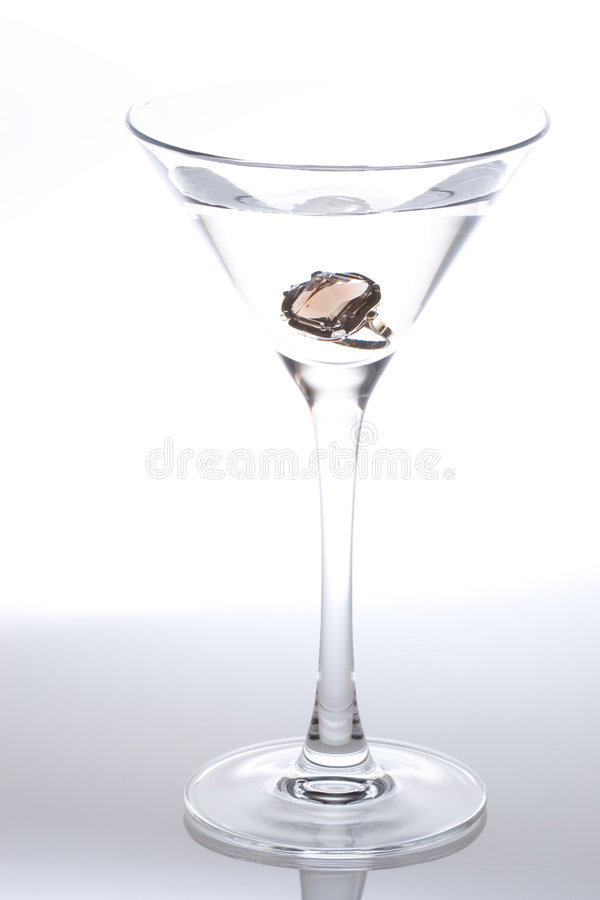 Download Engagement ring in glass stock photo. Image of martini - 3132920