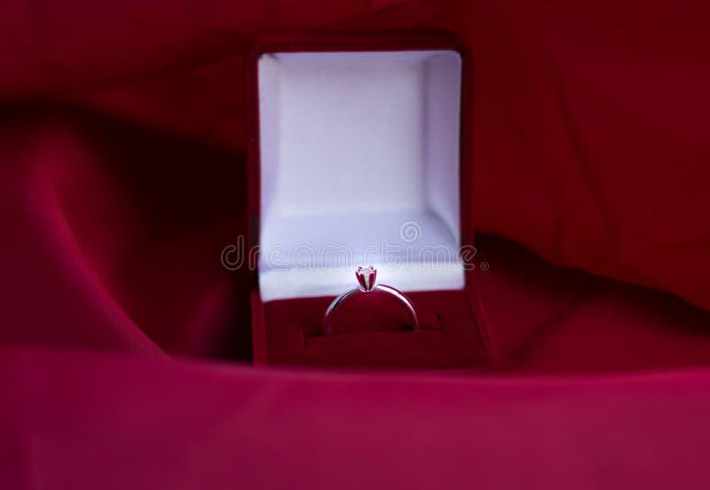 Engagement ring in velvet red box stock photography