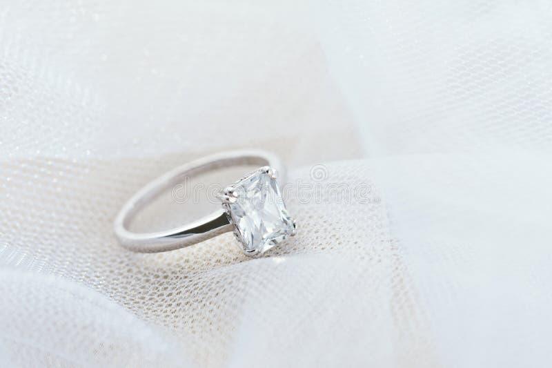 Engagement ring on white veil royalty free stock photo