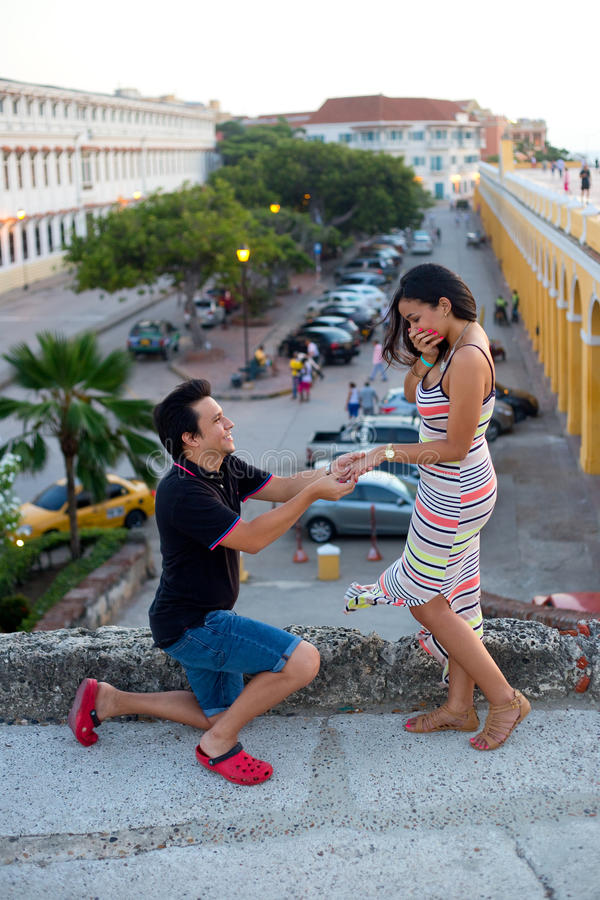 Engagement. Young men proposing to his girlfriend in Cartagena, Colombia royalty free stock photos