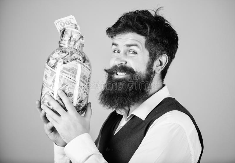 Engaging in investment activity. Happy businessman making a good investment. Bearded man investor smiling with royalty free stock photo