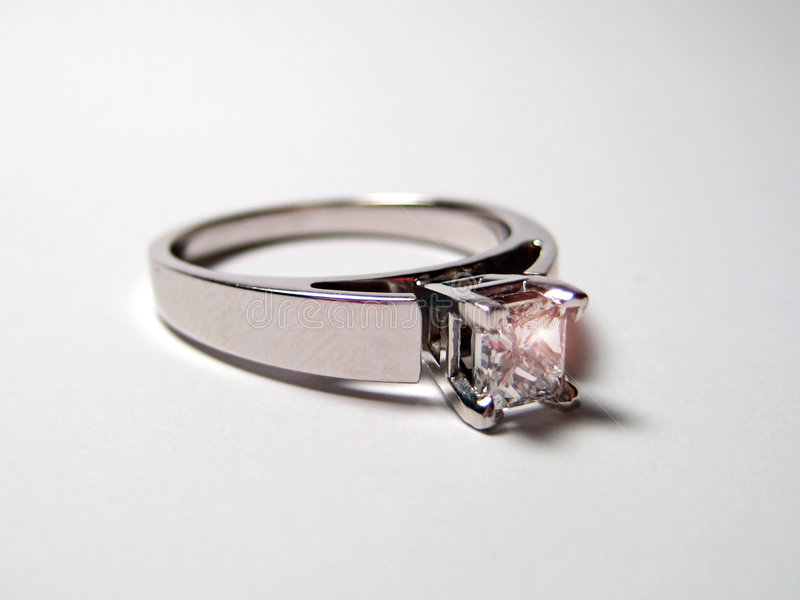 Engagment Ring. An engagement ring rests on a white surface royalty free stock image