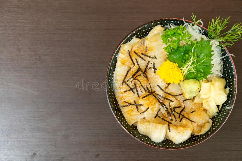 Engawa on topped rice bowl (donburi. ) - Japanese food style stock image