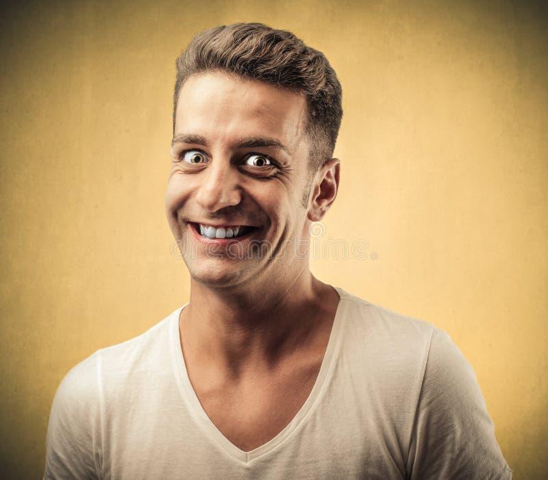 Enge glimlachende mens stock afbeelding