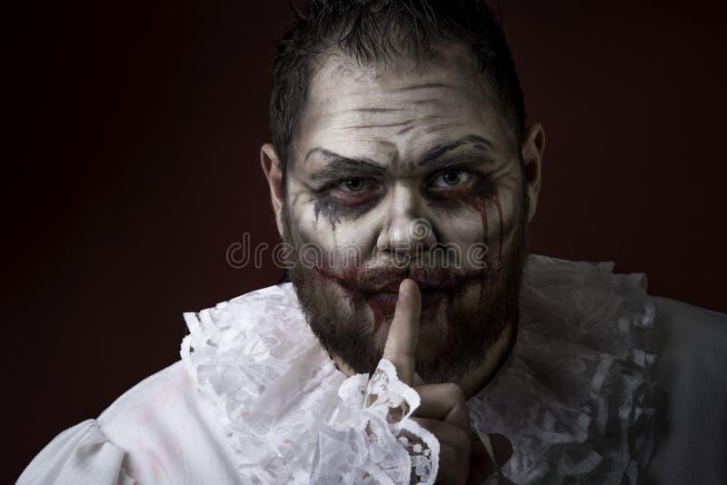 Enge kwade clown stock afbeelding