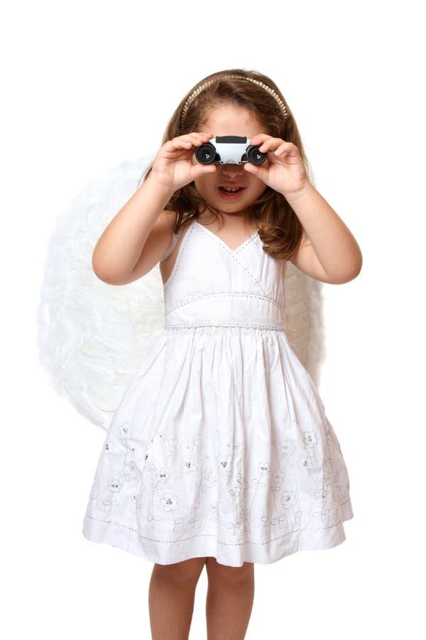 Engel die verrekijkers met behulp van royalty-vrije stock fotografie