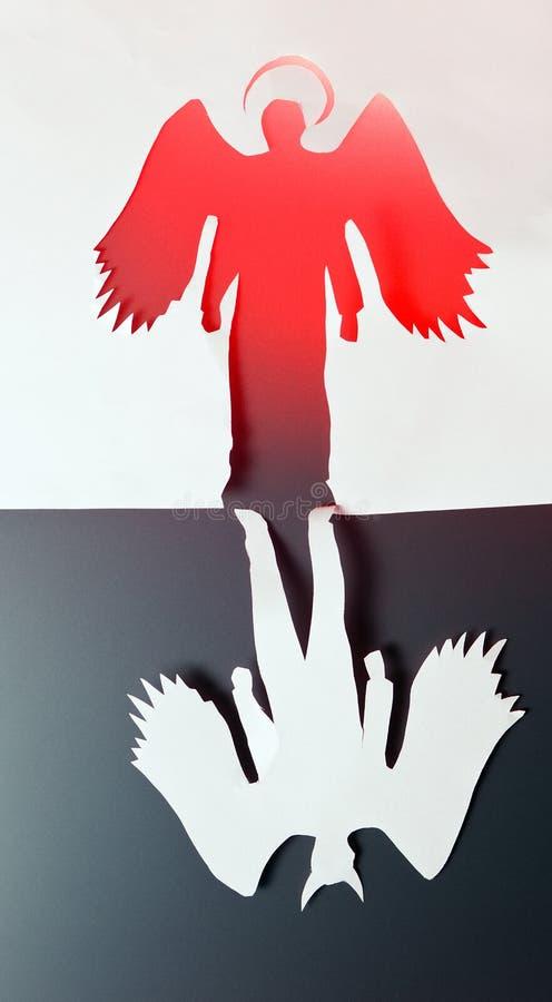 Engel en duivel stock foto