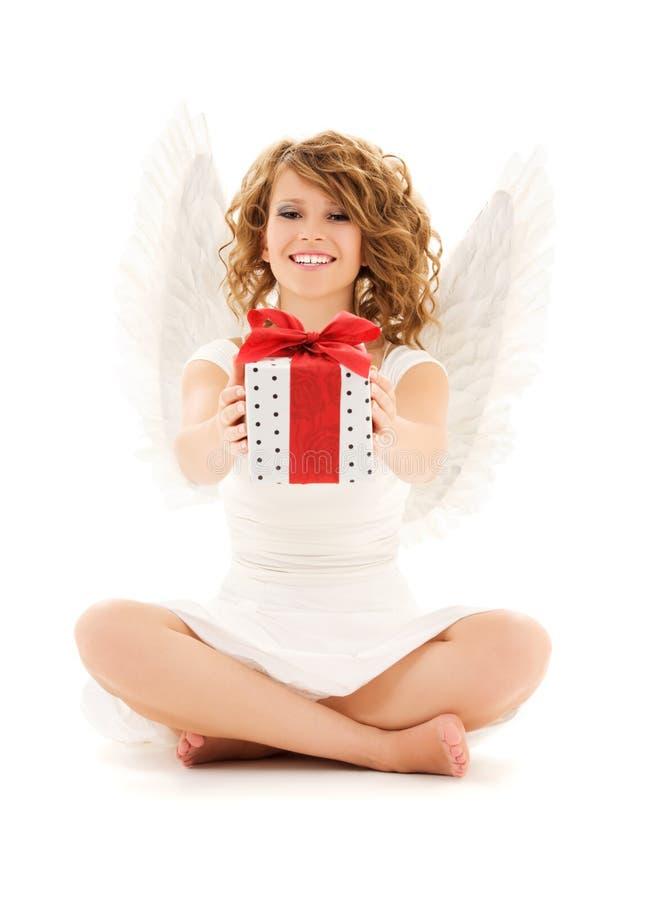 Engel met gift stock afbeeldingen