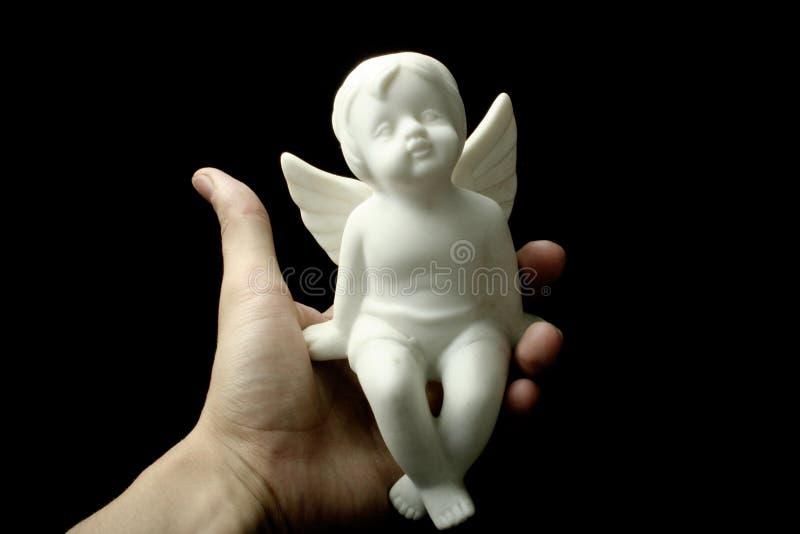 Engel in mijn hand stock fotografie