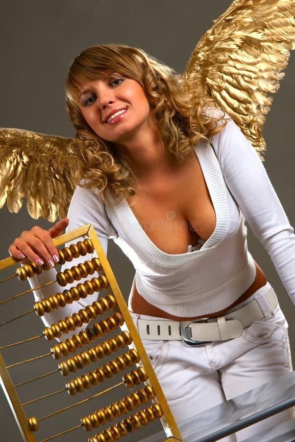 Engel mit einer goldenen Rechenmaschine lizenzfreie stockfotos