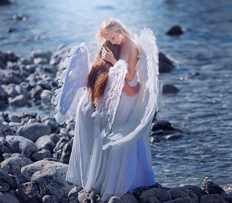 Engelen op het strand royalty-vrije stock foto's
