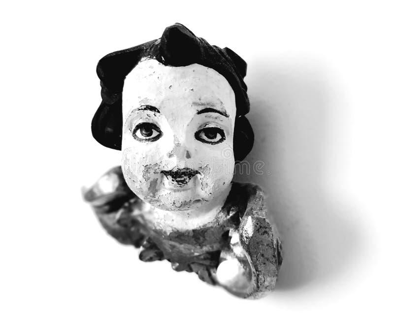 Engelengezicht over wit Zwart-wit engelenstandbeeld stock foto