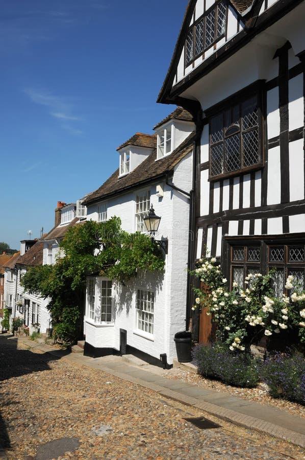 Engelse dorpsplattelandshuisjes. Rogge West-Sussex. stock afbeeldingen