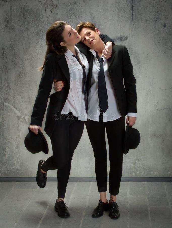Engelse kleding voor mamma en dochter stock foto