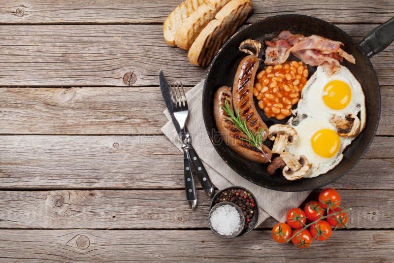 Engelse ontbijt Gebraden eieren, worsten, bacon royalty-vrije stock fotografie